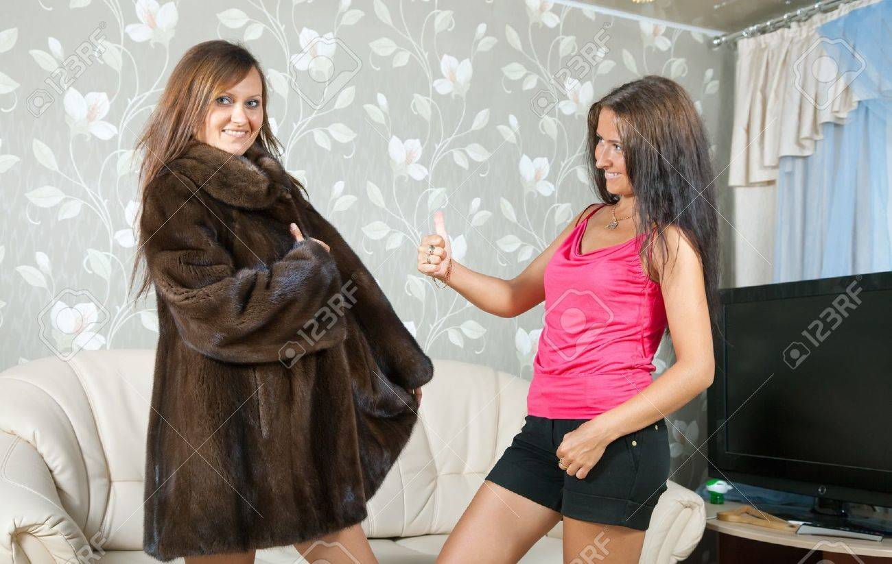Woman shows new fur coat to friend Stock Photo - 9977159