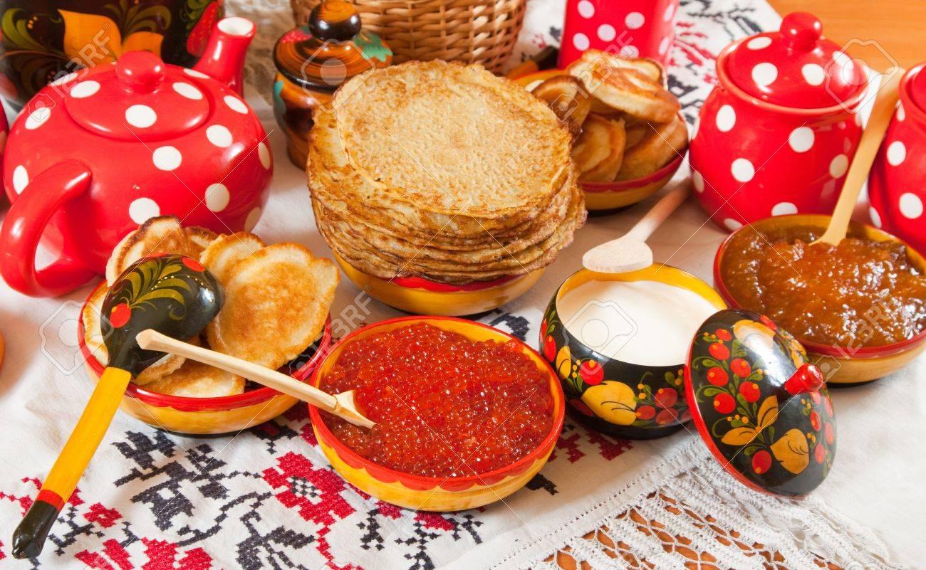Maslenitsa festival meal - pancake with caviar and tea Stock Photo - 10352354