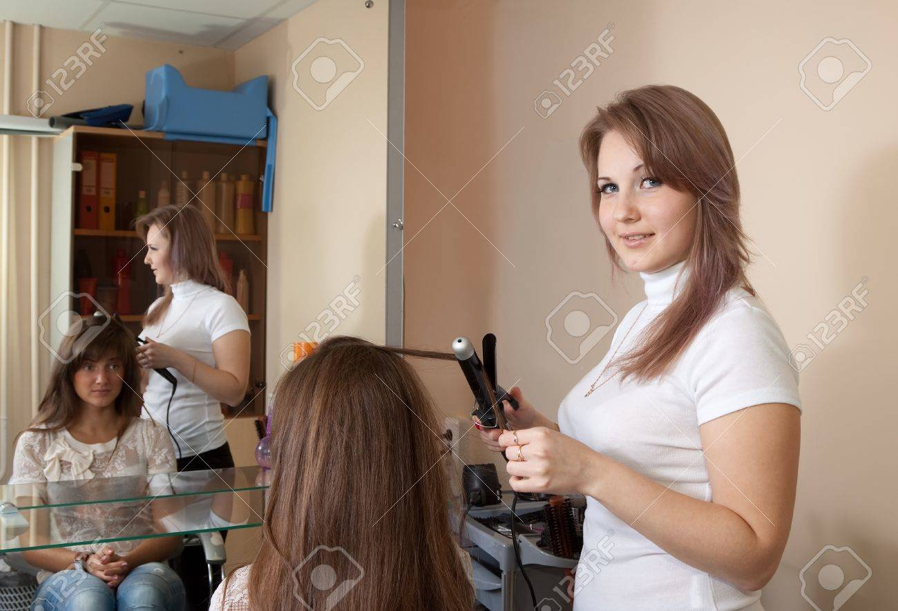 Female hairdresser working with long-haired girl Stock Photo - 10704874