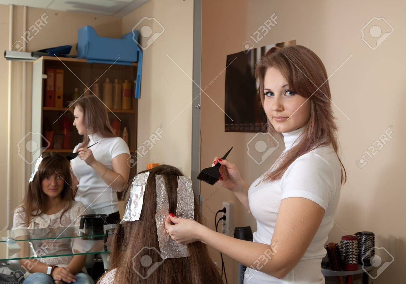 hair stylist coloring   long-haired girl hair Stock Photo - 10704883
