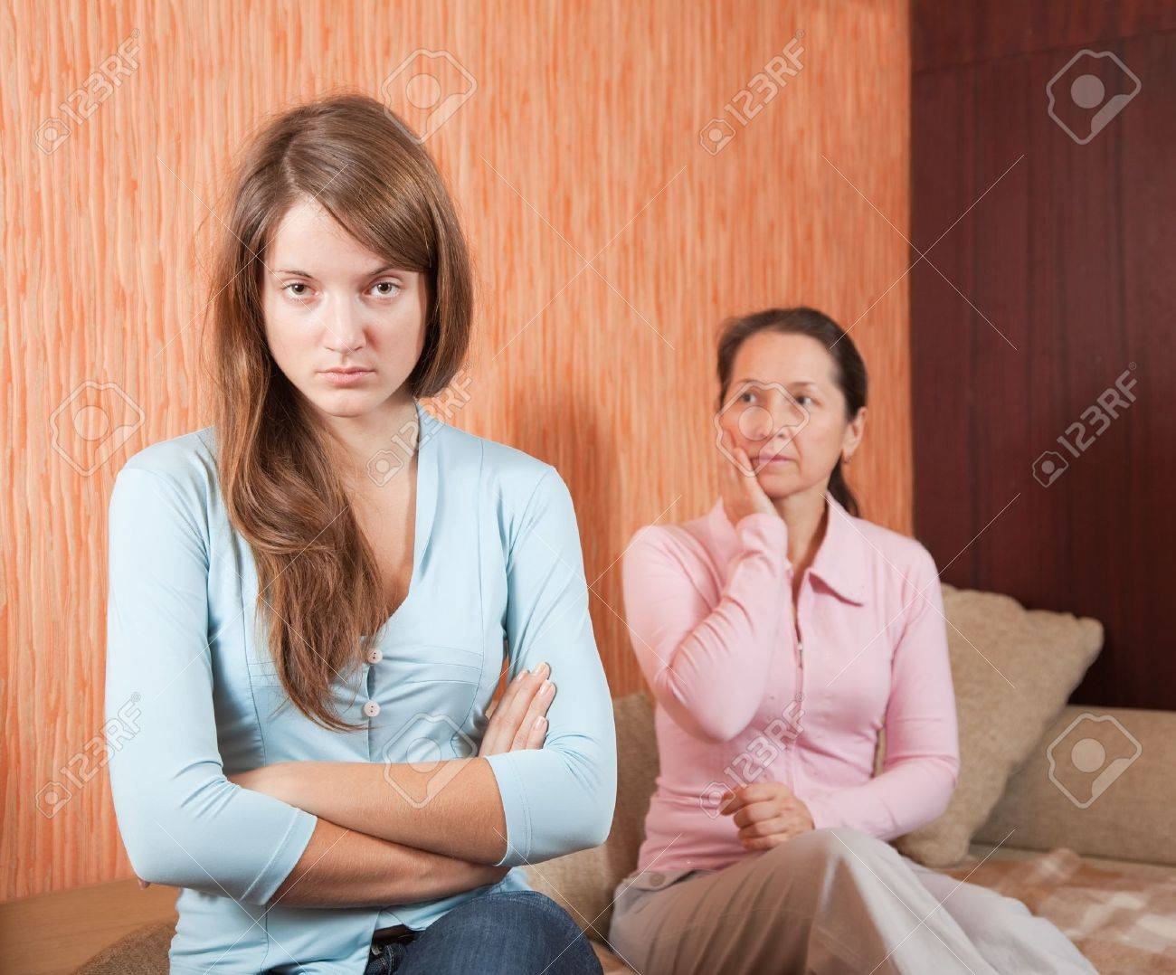 Mother and teen daughter having quarrel at home Stock Photo - 10741829