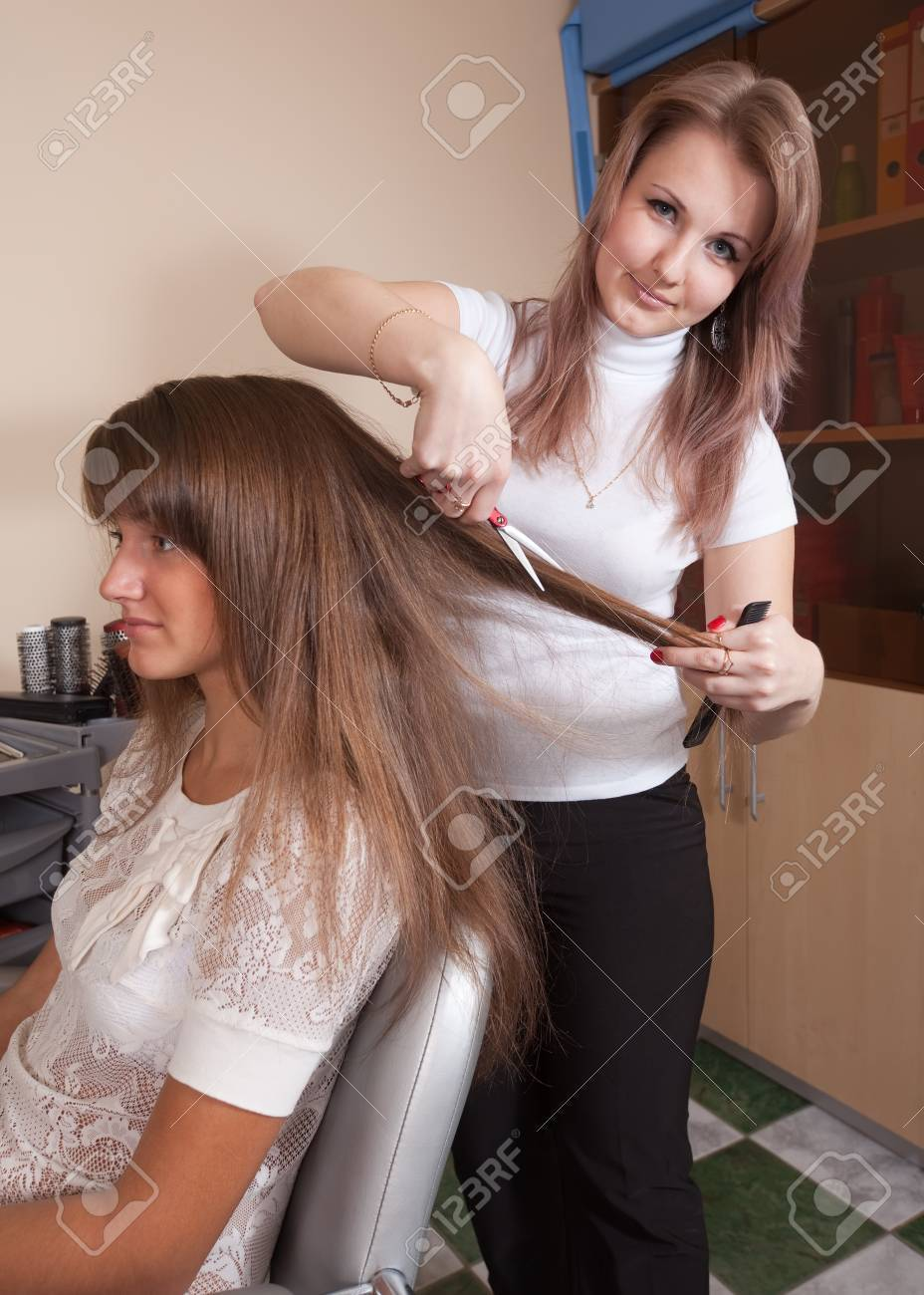Female hairdresser working with long-haired girl Stock Photo - 10812578