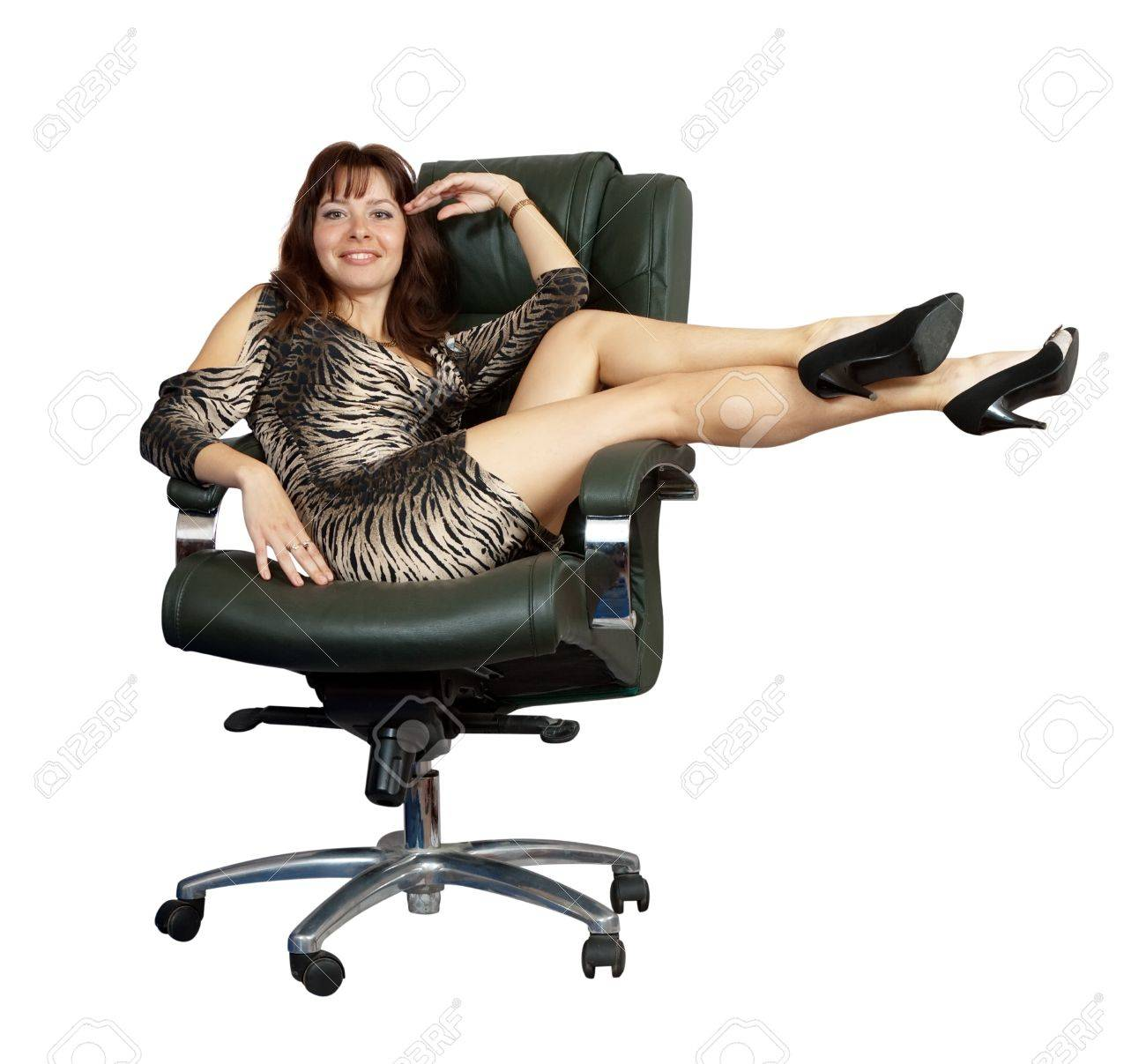 Sexy Woman Sitting On Luxury Office Armchair, Isolated Over White  Background Stock Photo   10885608