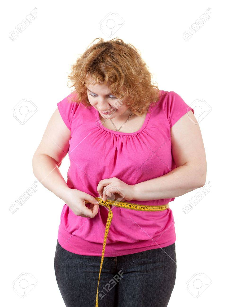 Overweight woman measuring waist. Isolated over white background - 11069982