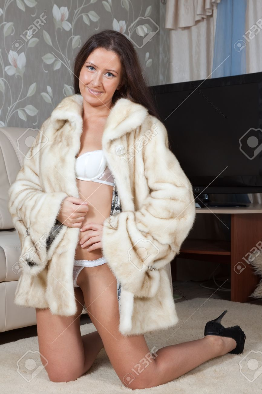Sexy Woman In Fur Coat At Home Interior Stock Photo, Picture And ...