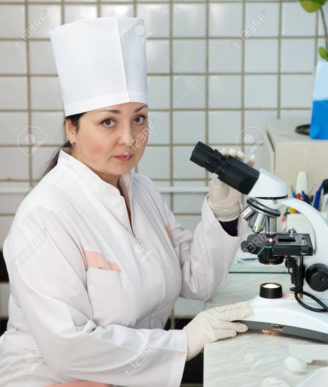 Woman doctor with microscope in lab Stock Photo - 11636230