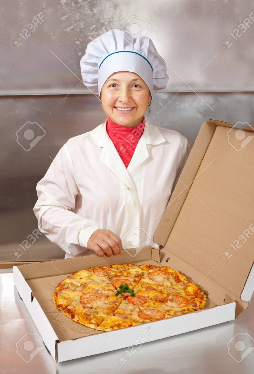 female cook with cooked pizza in box Stock Photo - 11805588