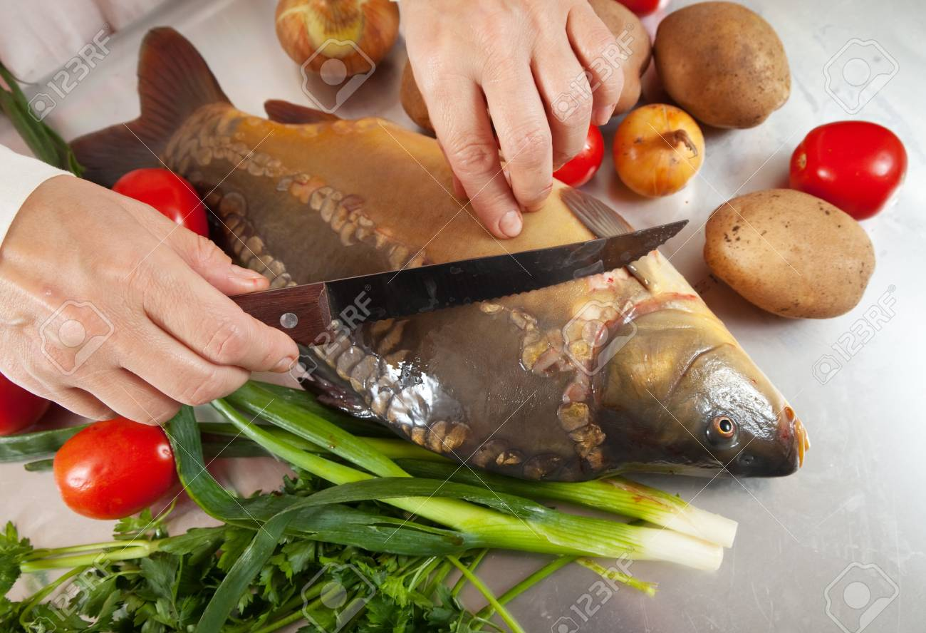 Closeup of cook cooking fish  in kitchen Stock Photo - 11955179