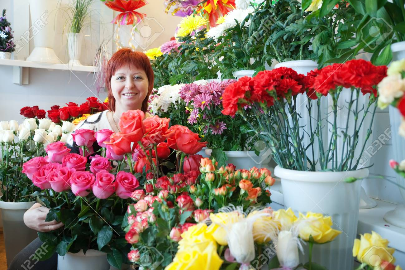 woman in the shop surrounded by different flowers Stock Photo - 11991686