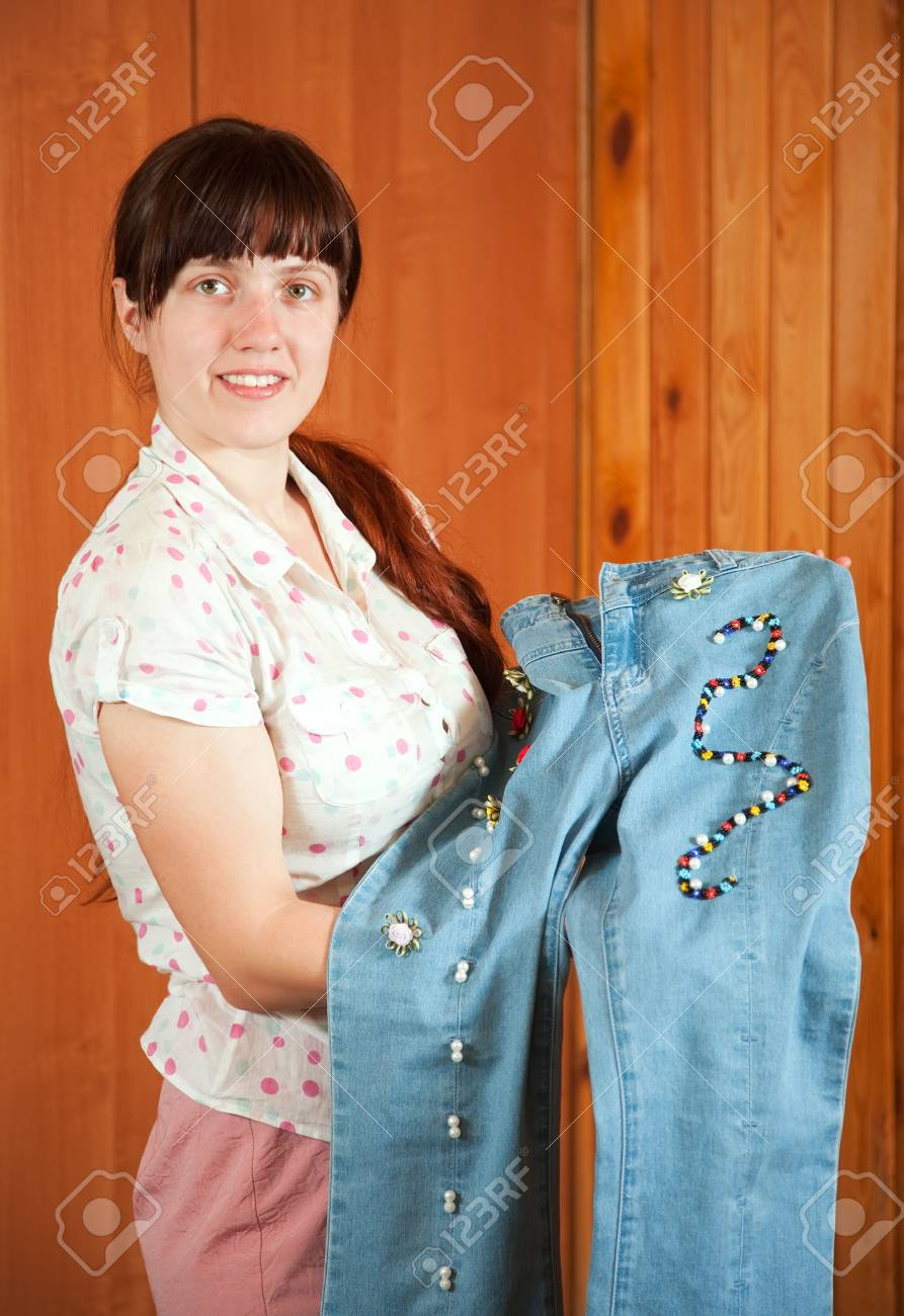 Woman shows a handmade jeans beaded by herself Stock Photo - 12288915