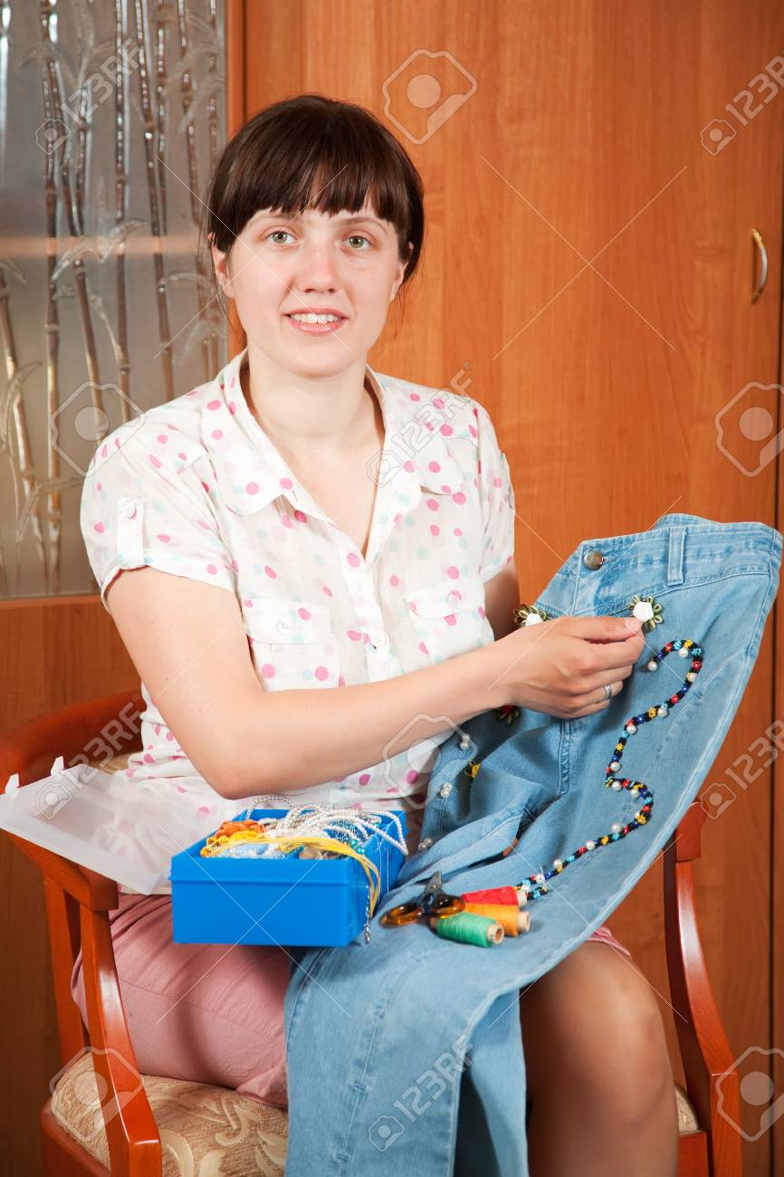Woman decorating cloth with bead Stock Photo - 12288830