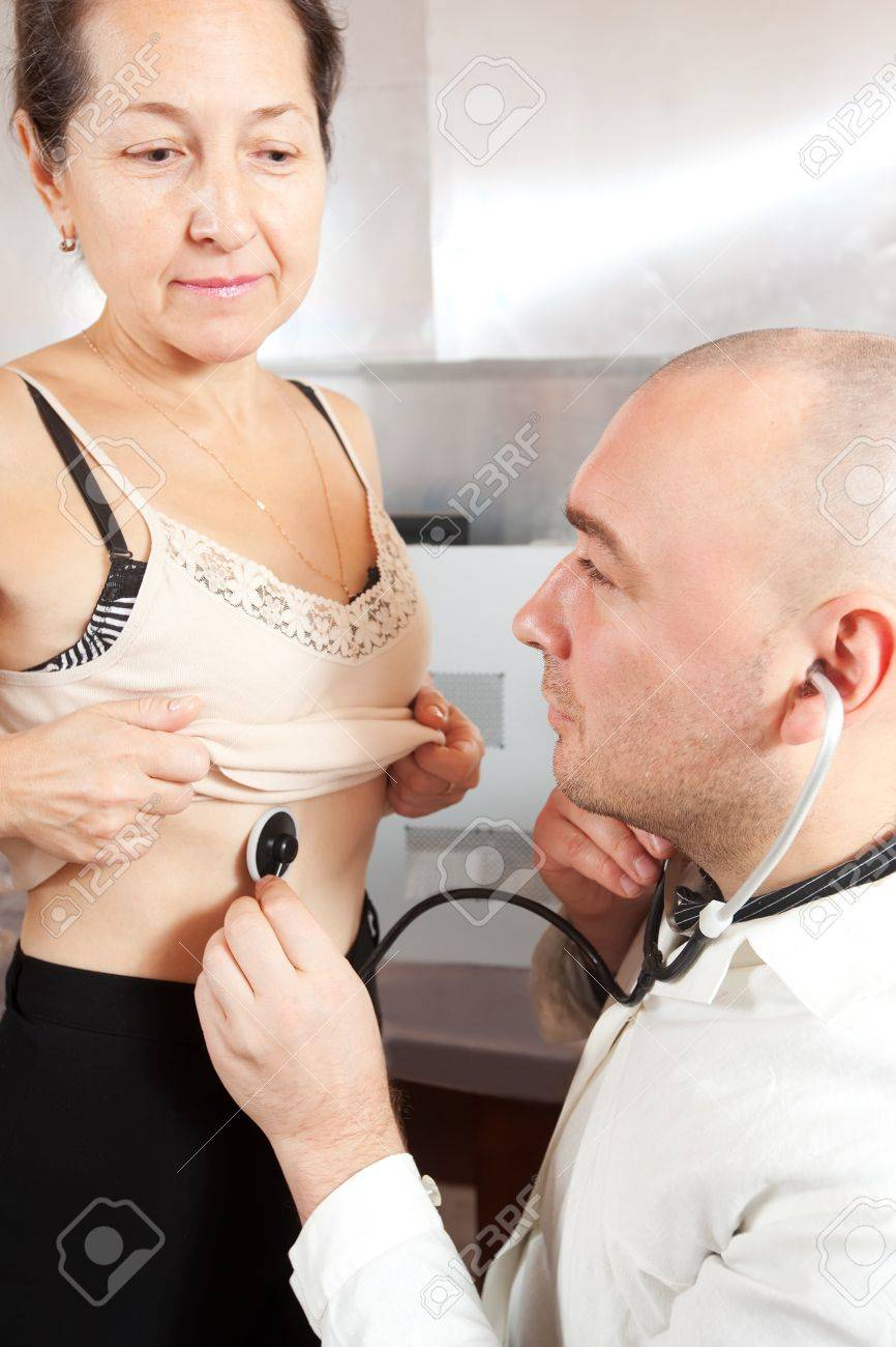 Male doctor examining the patient in clinic Stock Photo - 12289009