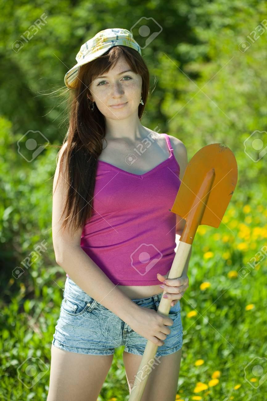 Happy female gardener with spade outdoor Stock Photo - 12612788