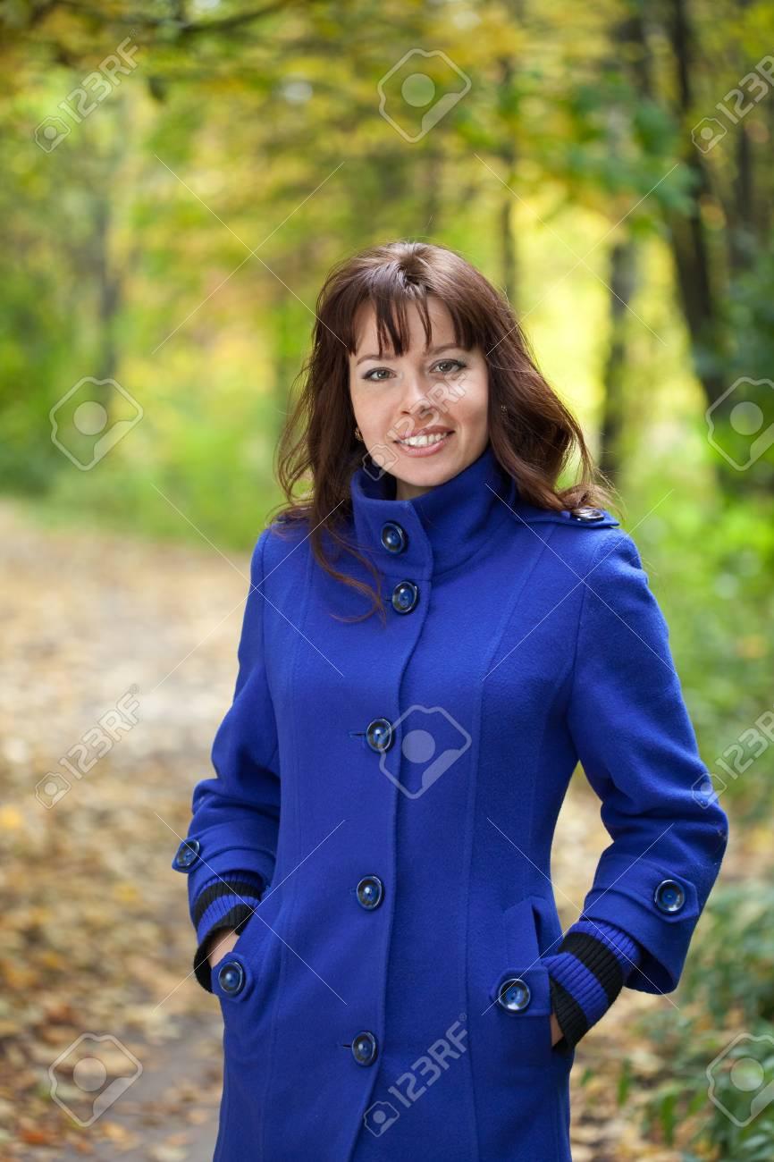Portrait of brunette woman in autumn park Stock Photo - 12612771