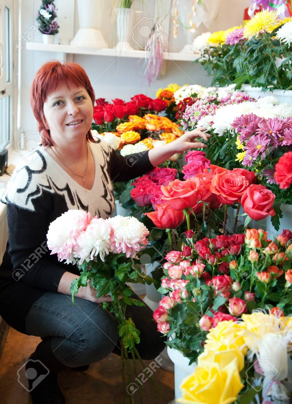 Female florist in her small  flower shop Stock Photo - 12791536