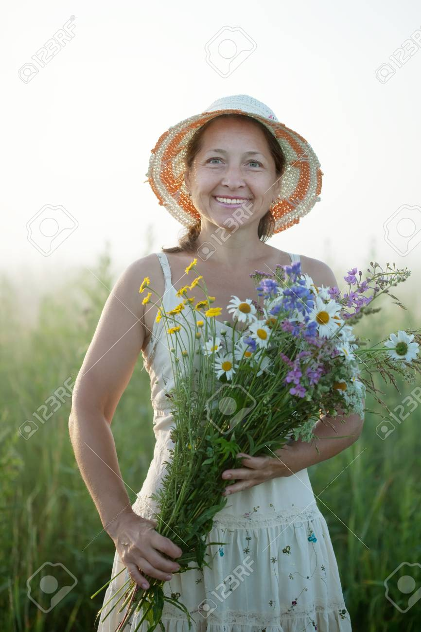 Outdoor portrait of   woman with flowers posy Stock Photo - 12791557