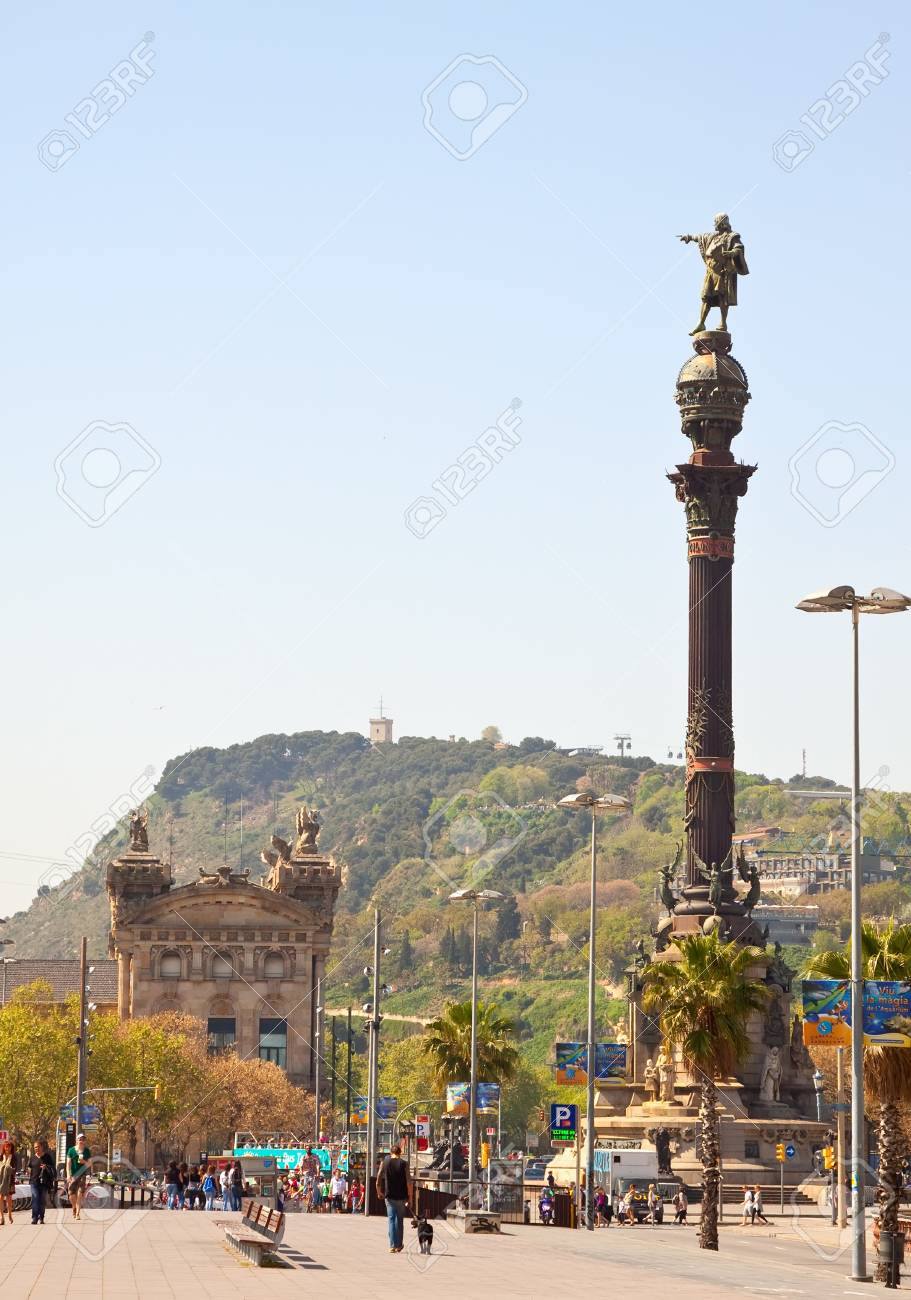 BARCELONA, SPAIN - APRIL 12: Tourists walking near Columbus monument in April 12, 2011 in Barcelona, Spain.  Columbus Monument is 60 m. It is located at finish La Rambla and built in 1888 Stock Photo - 12768616