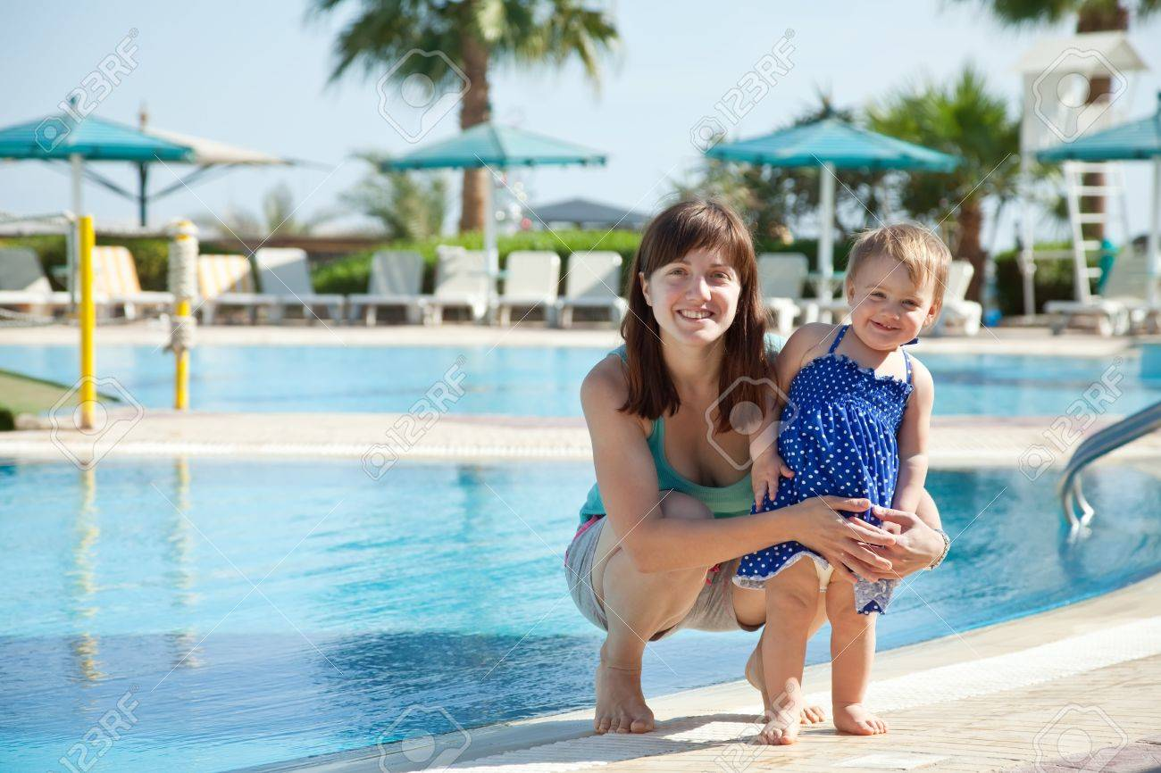 happy mother with  toddler   at resort hotel area Stock Photo - 13086907