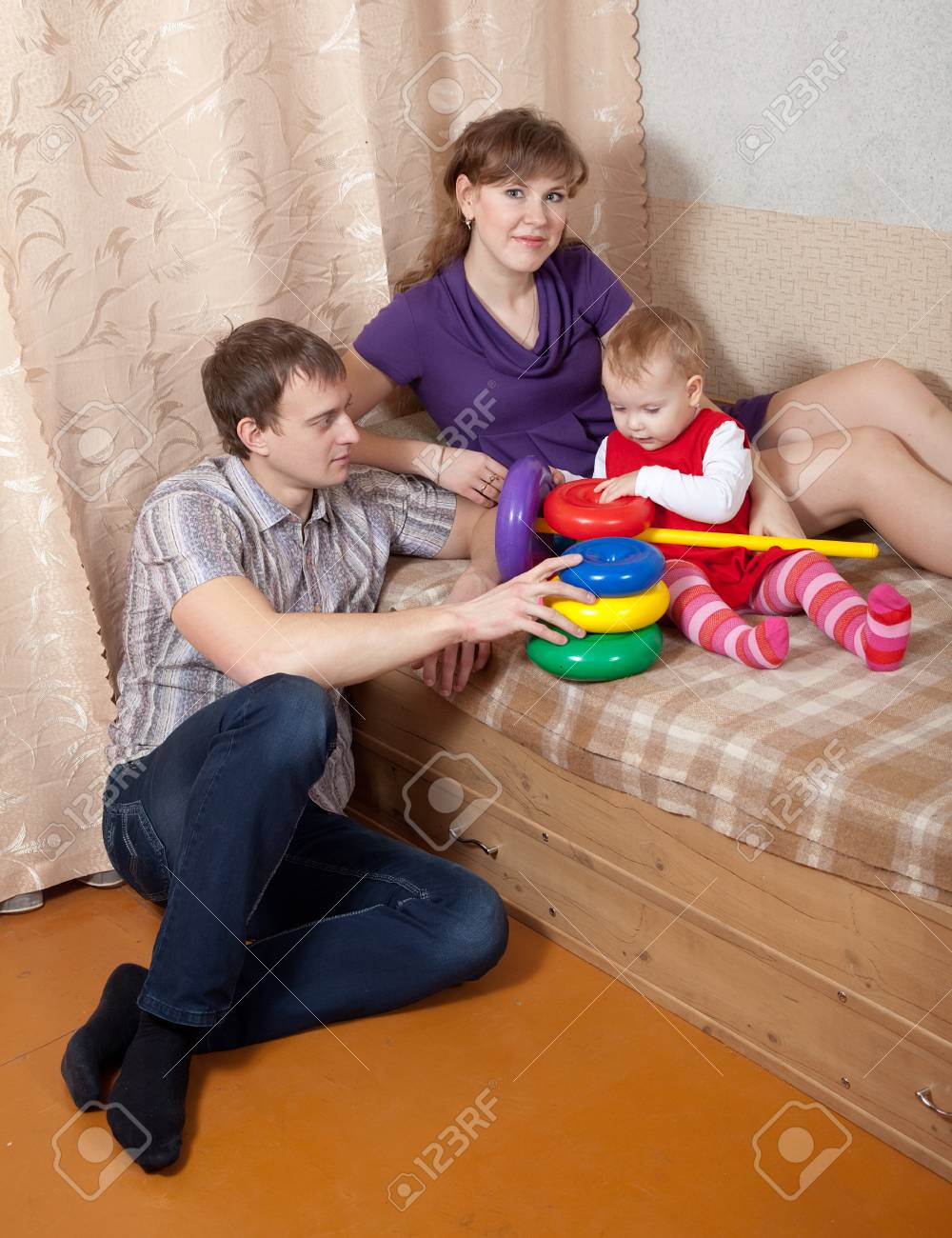 Family  relaxing at home on sofa Stock Photo - 13394887