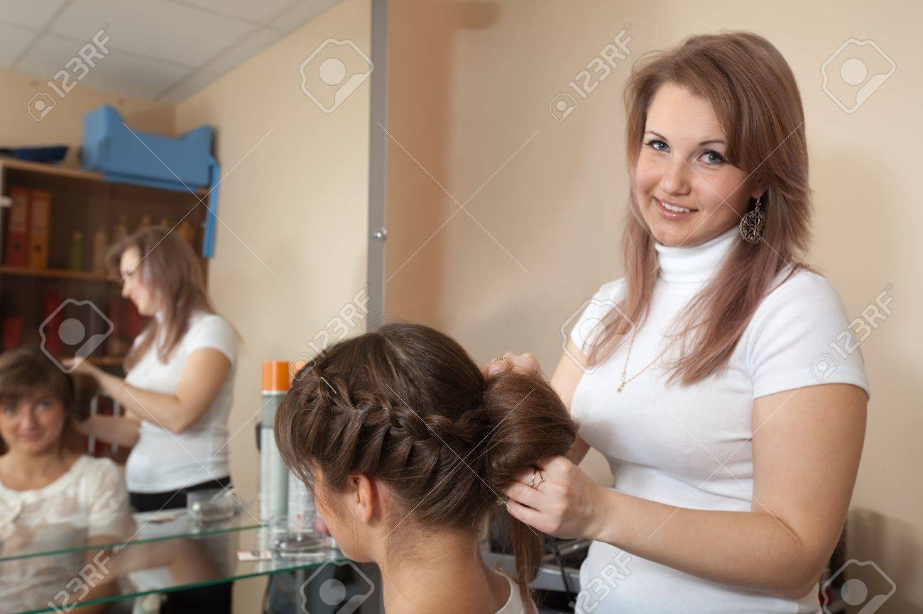 Female hair stylist working with long-haired girl Stock Photo - 13865547