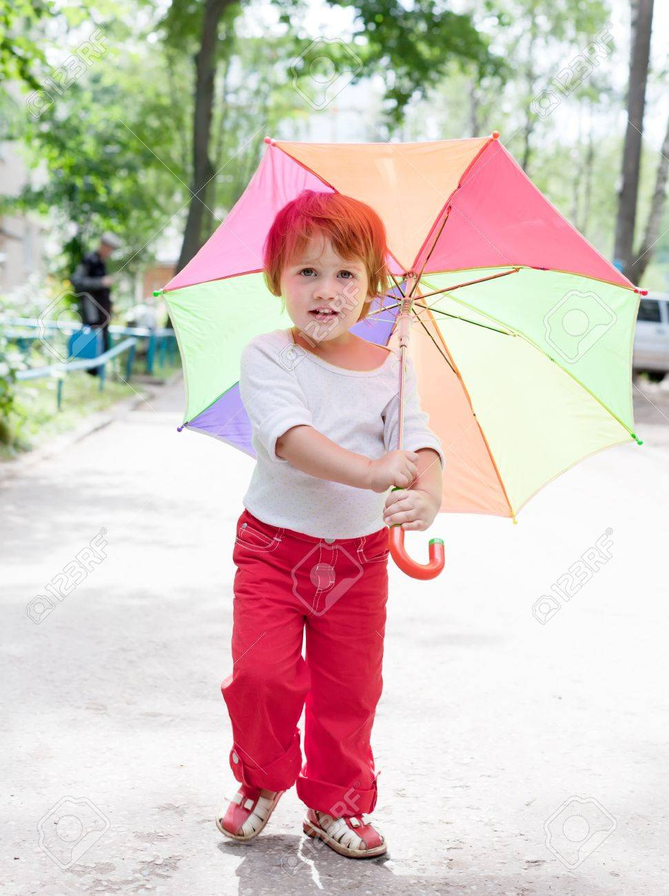 Two-year baby girl with umbrella in summer Stock Photo - 14724749