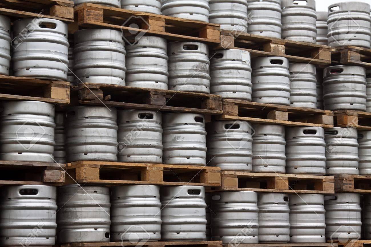 Many metal kegs of beer in regular rows Stock Photo - 14979755