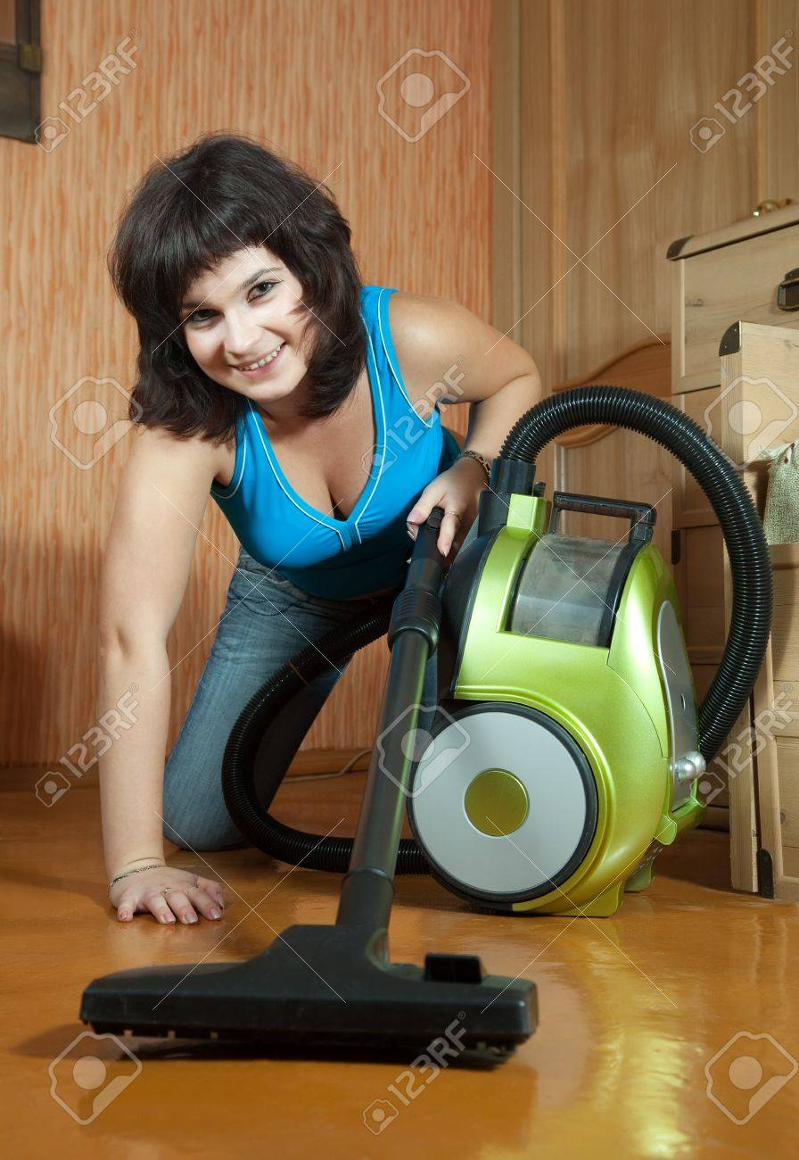 girl cleans with vacuum cleaner at home Stock Photo - 15256117