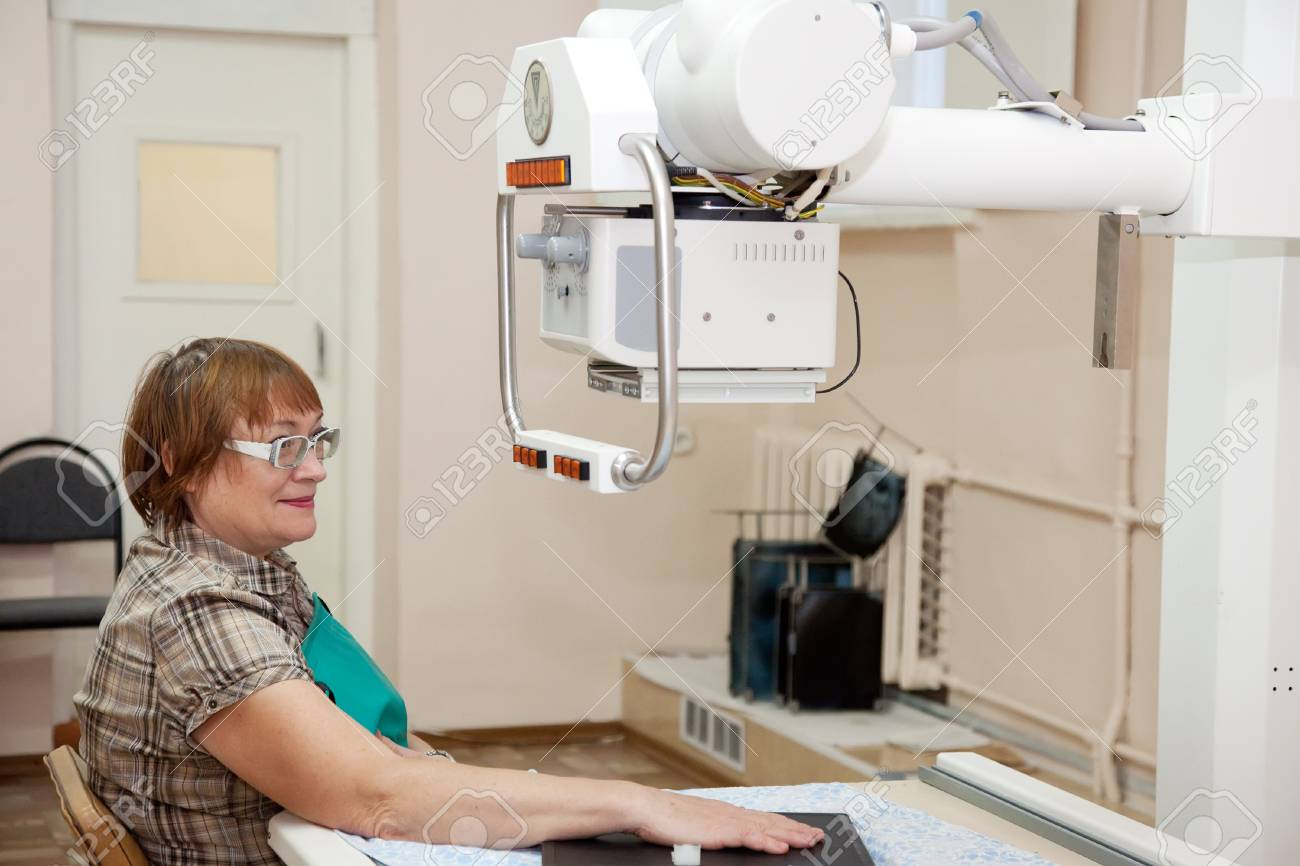 patient during  hand x-rays exam in clinic Stock Photo - 16563230