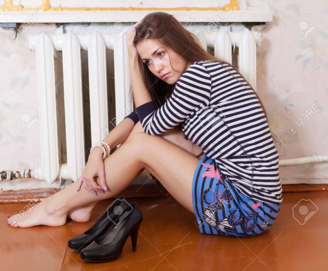 Lonely girl sitting on the floor in the corner Stock Photo - 15978250