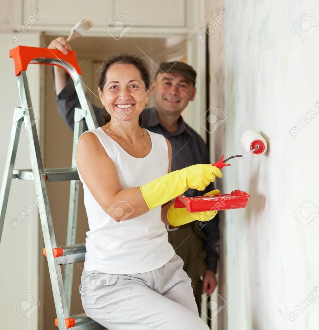Mature woman and man making repairs at home Stock Photo - 16545542