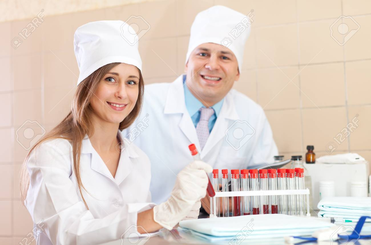 Male doctor and nurse with test tubes makes blood test in medical laboratory Stock Photo - 16709633