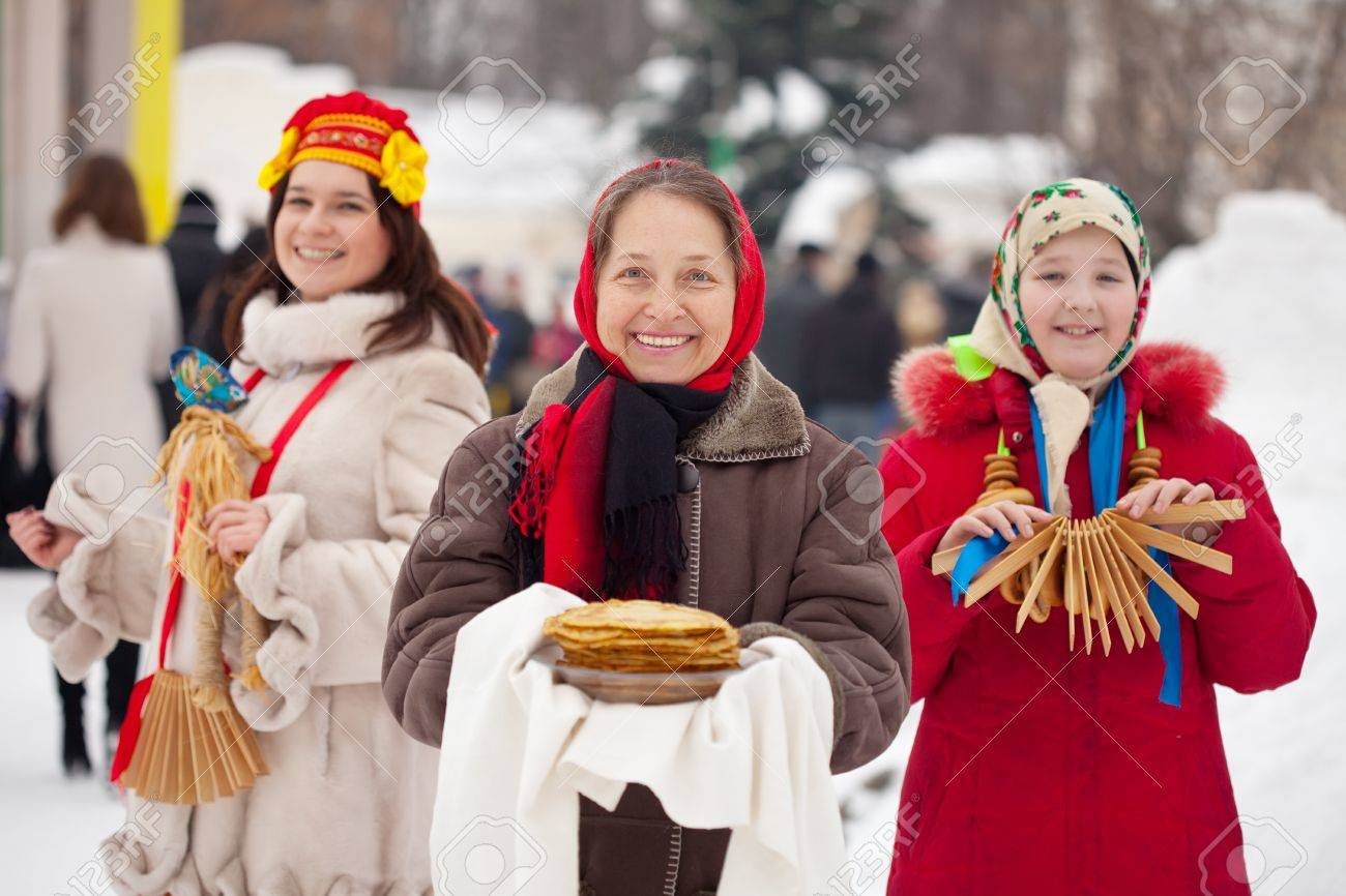 women in russian traditional clothes pancake and round stock photo women in russian traditional clothes pancake and round cracknel during shrovetide