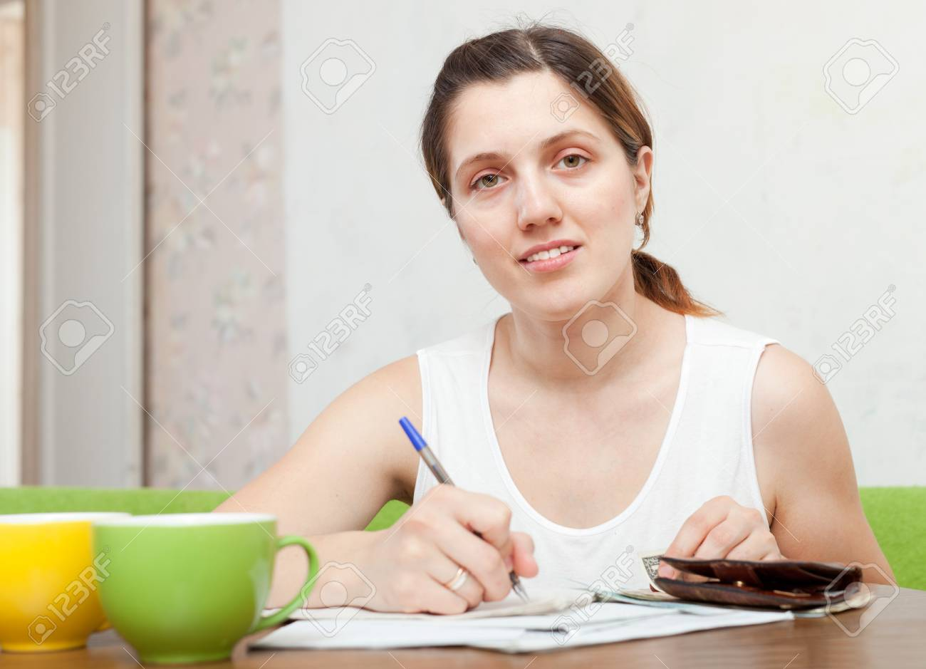 woman fills in documents at home Stock Photo - 16826564