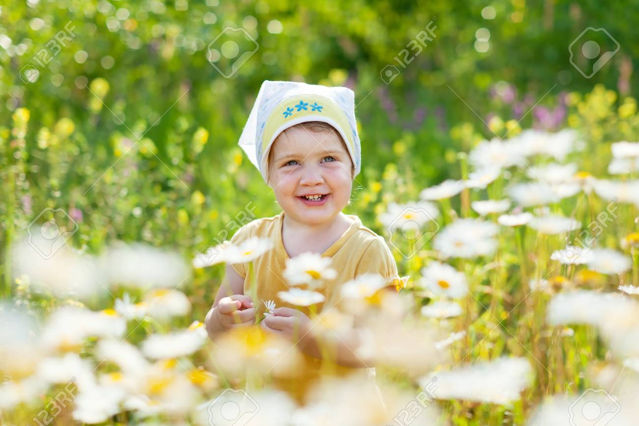 Two-year baby girl in daisy meadow Stock Photo - 16862841