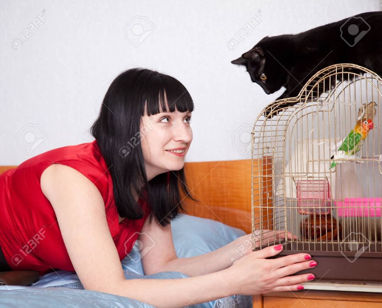woman in red with  pets in home Stock Photo - 16902121