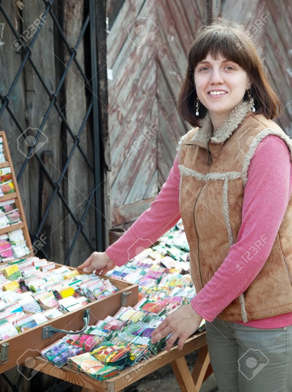 Female gardener buys the seeds on the market Stock Photo - 17493048