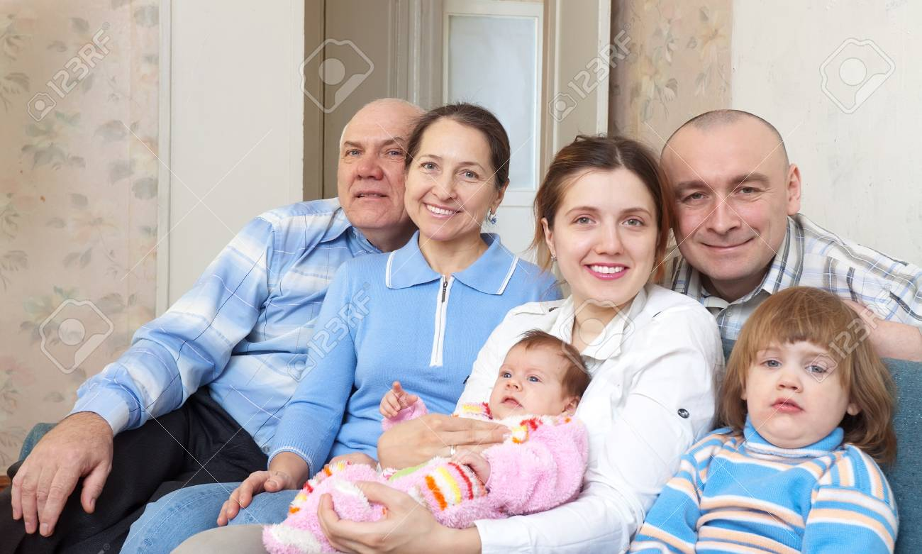 Happy mature couple with their offspring at home Stock Photo - 18359650
