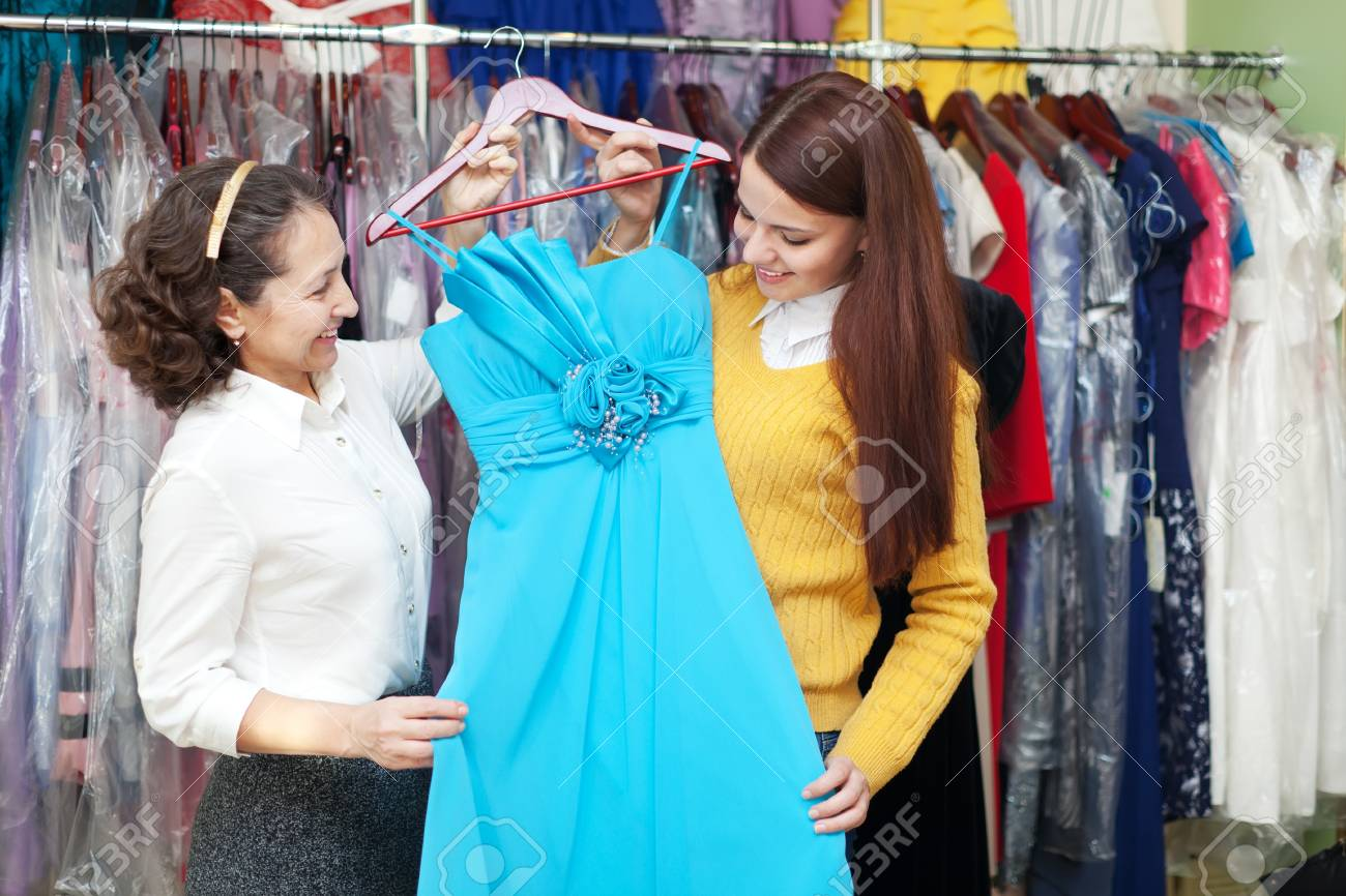Two Women Chooses Blue Evening Gown Shop Of Fashionable Clothes ...