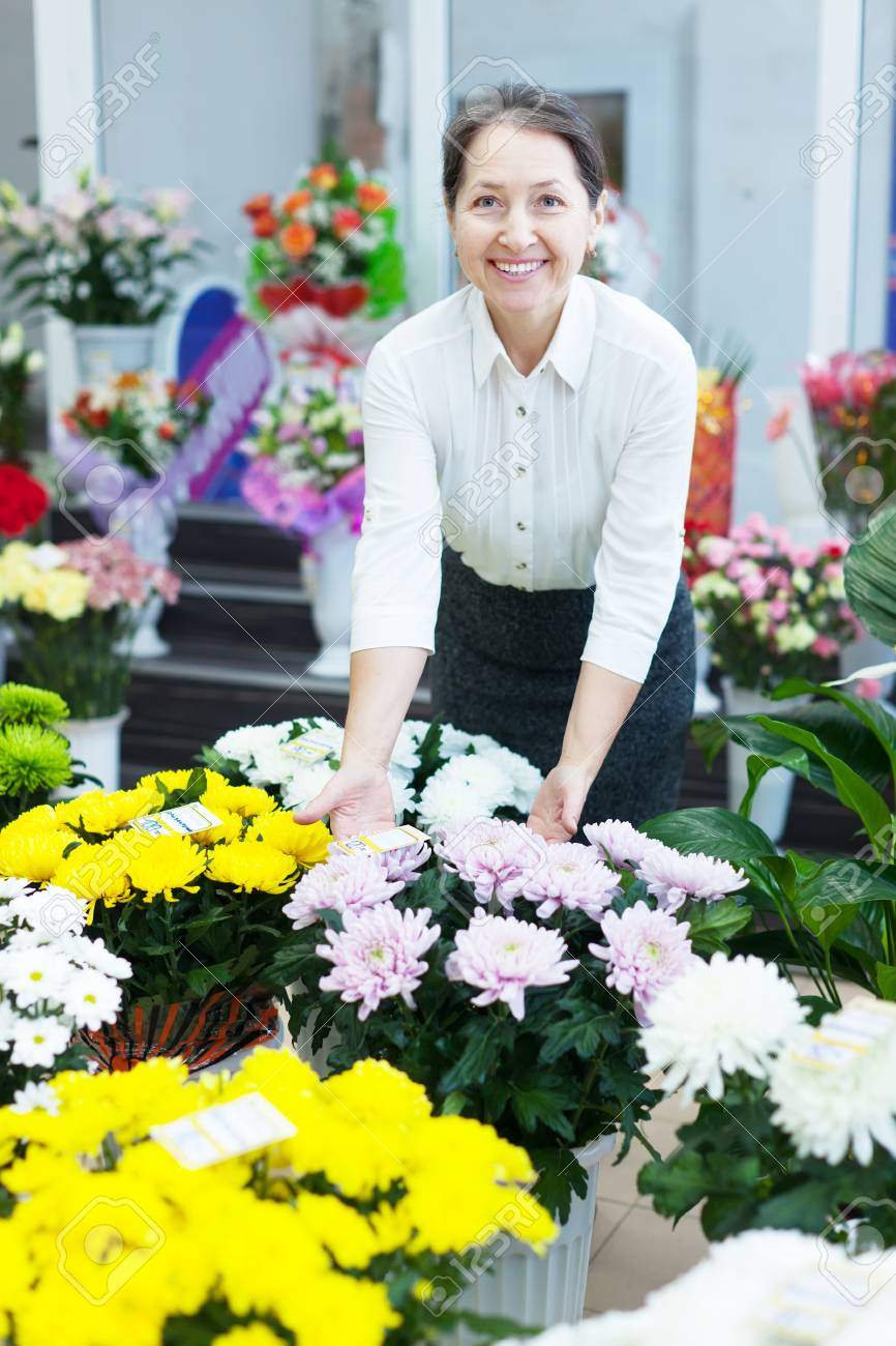 mature woman in the shop surrounded by different flowers Stock Photo - 18655013