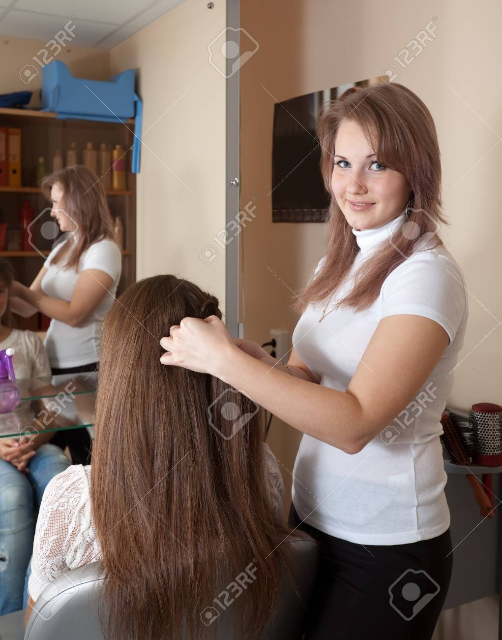 Female hairdresser works on woman hair in salon Stock Photo - 18872416