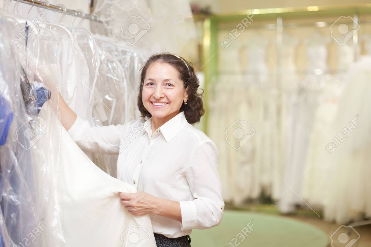 Friendly Shop Consultant At Shop Of Wedding Fashion Stock Photo ...