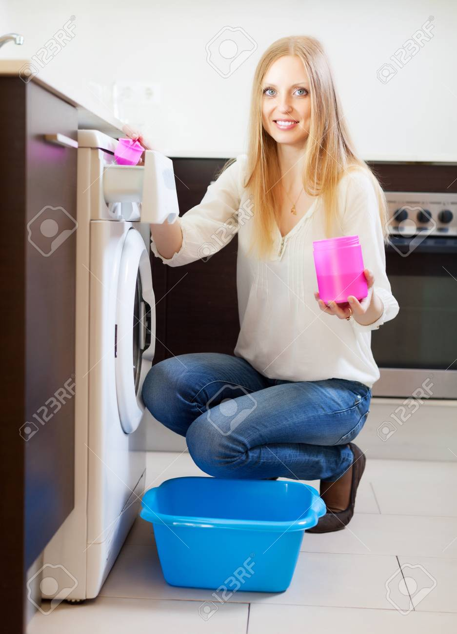 woman doing laundry with detergent at home Stock Photo - 20311963