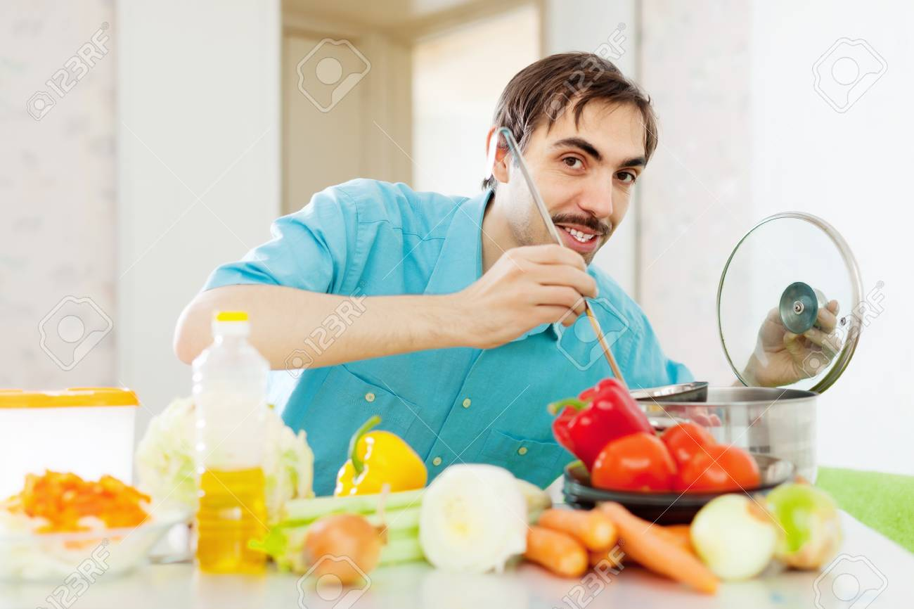 Positive Guy Doing Vegetarian Lunch At Kitchen Stock Photo, Picture ...