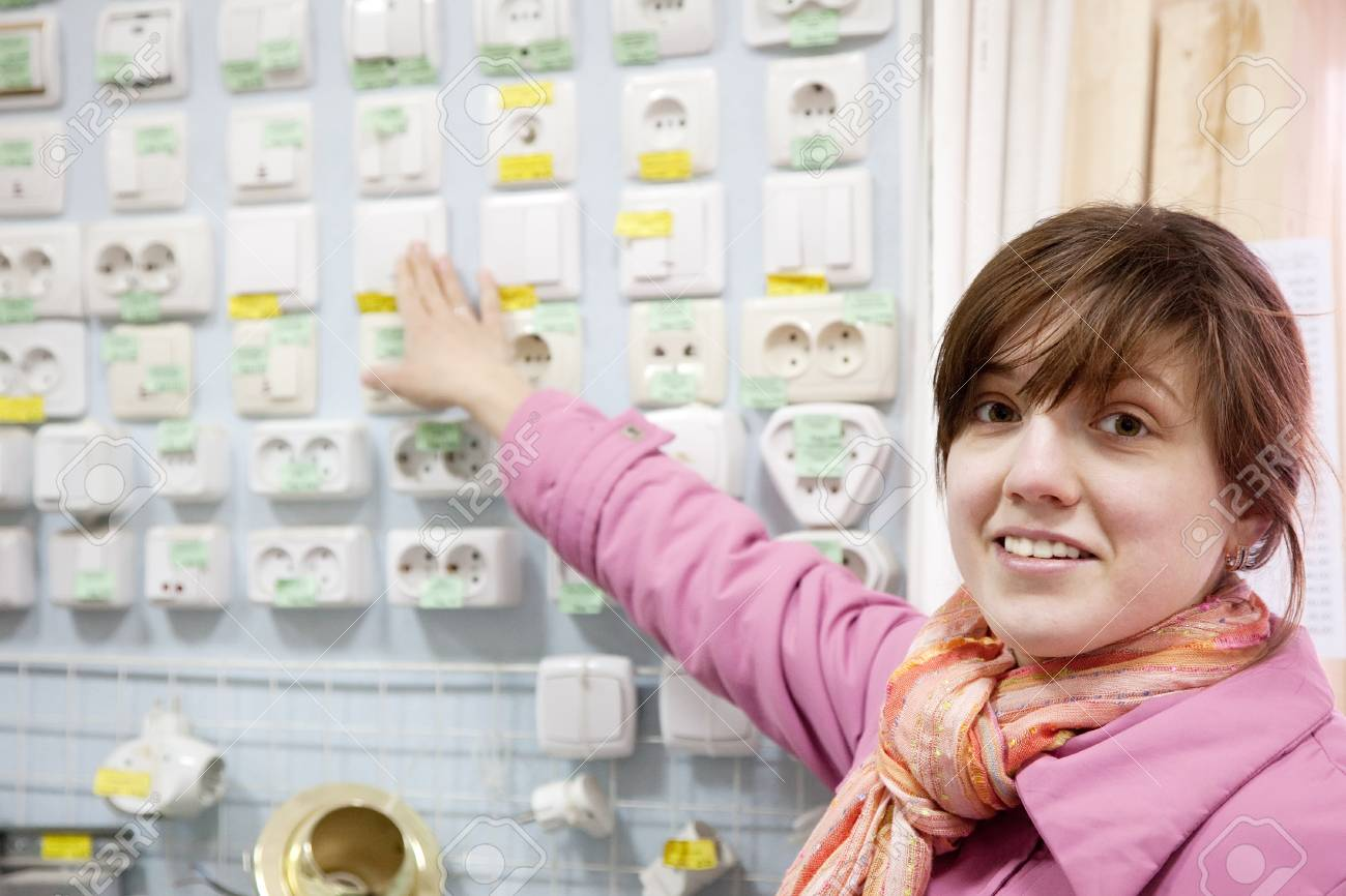 Young woman chooses  socket in  electrical store Stock Photo - 20922424