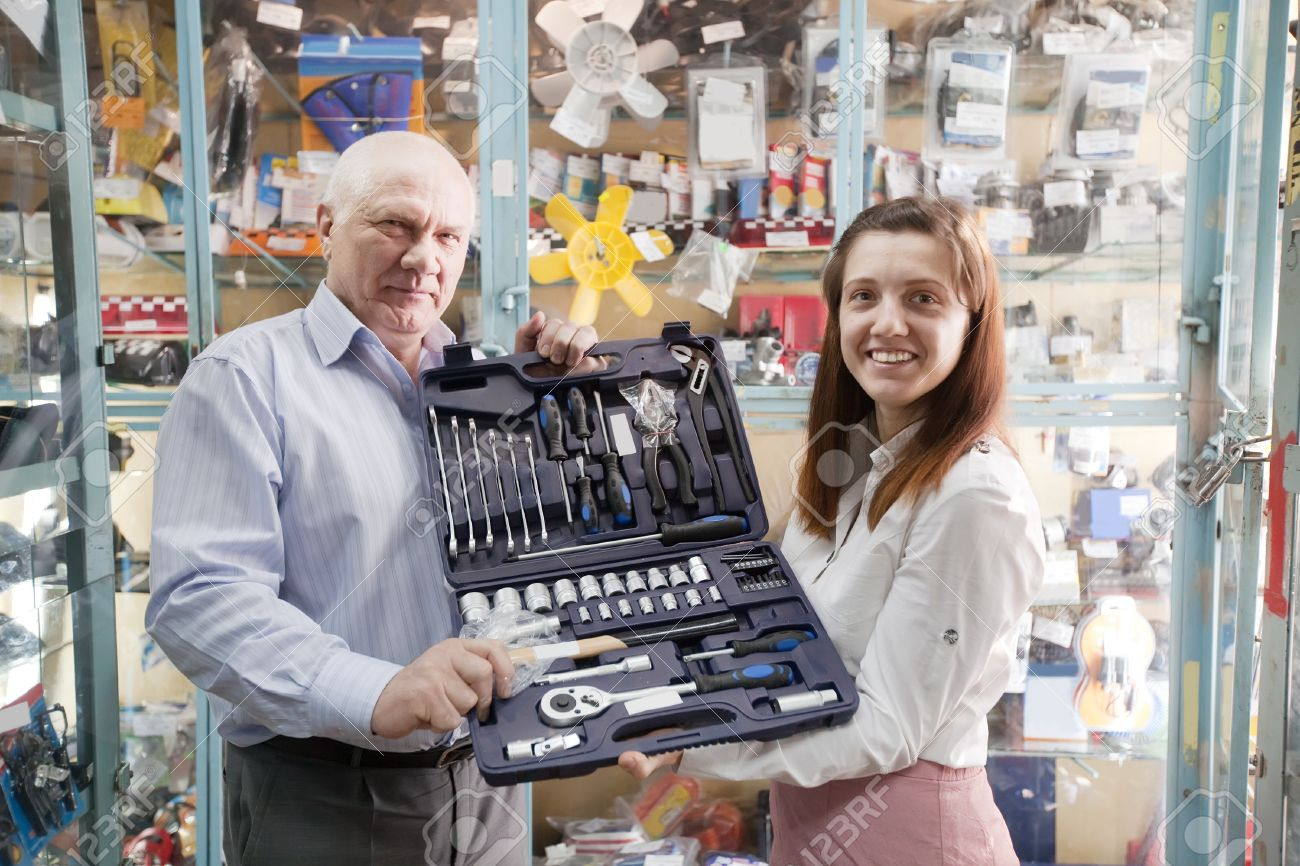 mature man and woman holds  automotive  correction tool set in  auto parts store Stock Photo - 20945253
