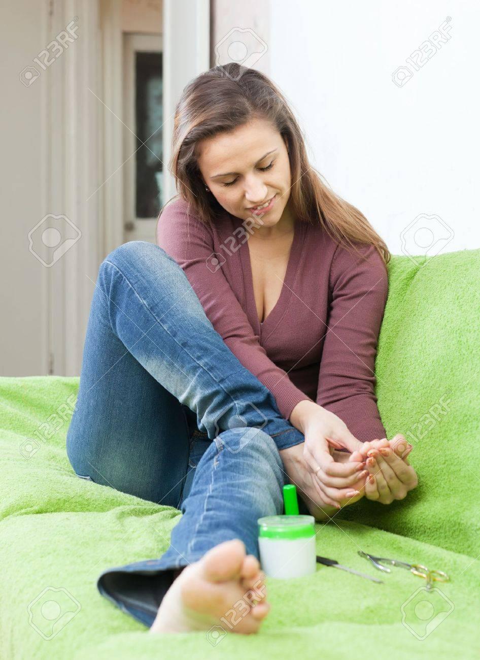 beauty woman treats her toenails at home Stock Photo - 21022728