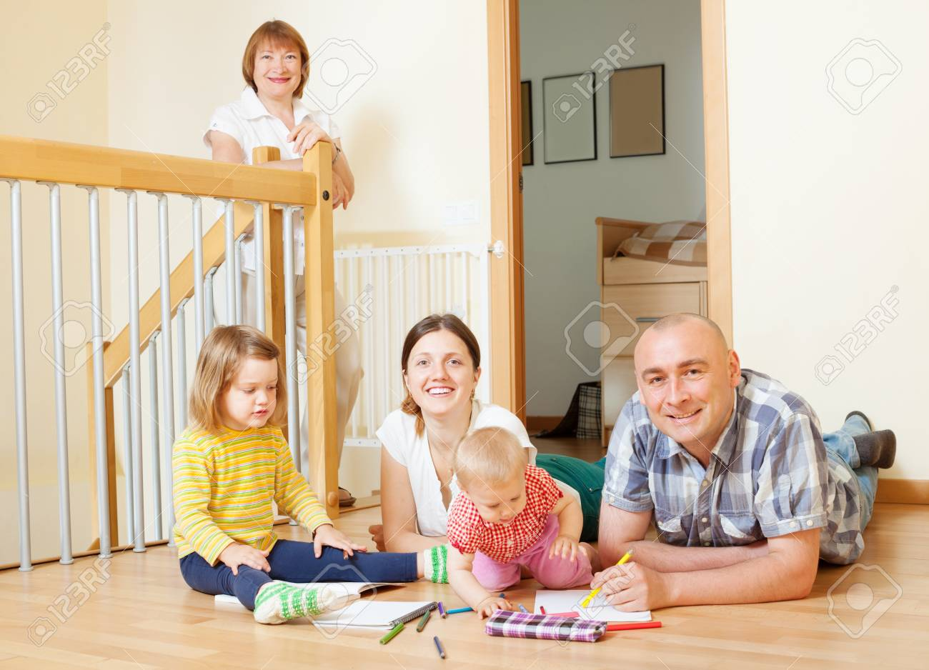 married couple with children and  grandmother in home interior together Stock Photo - 21234299