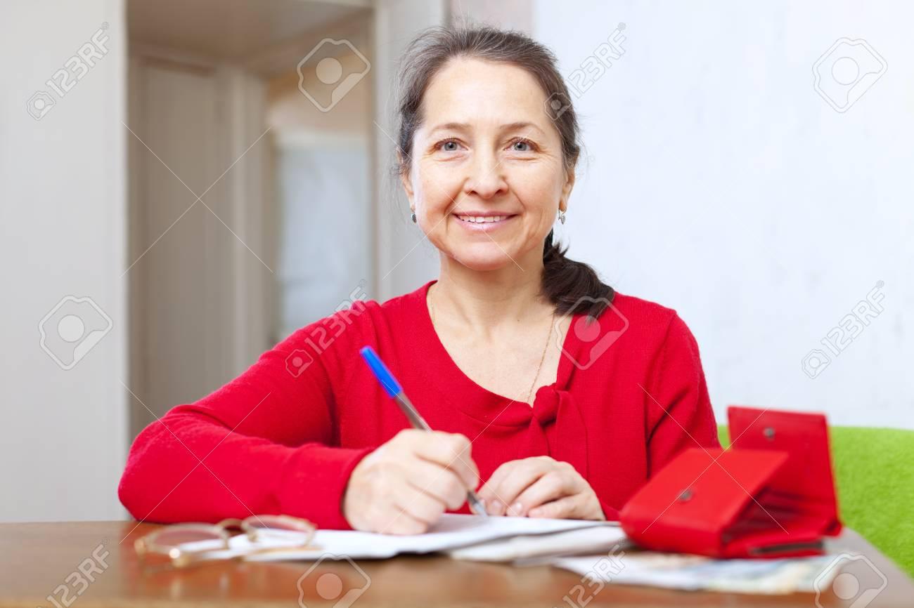 joyful mature woman with bill and money Stock Photo - 21500449