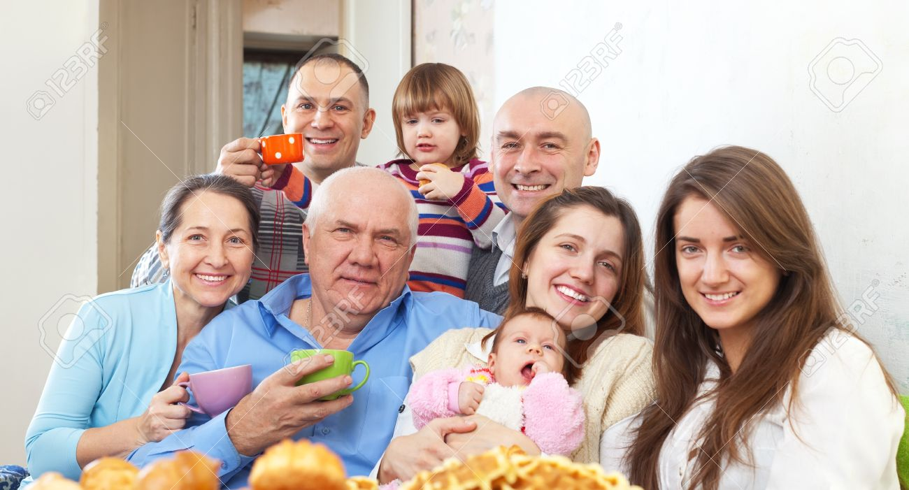 Portrait of big happy family communicate over tea at home Stock Photo - 21975763