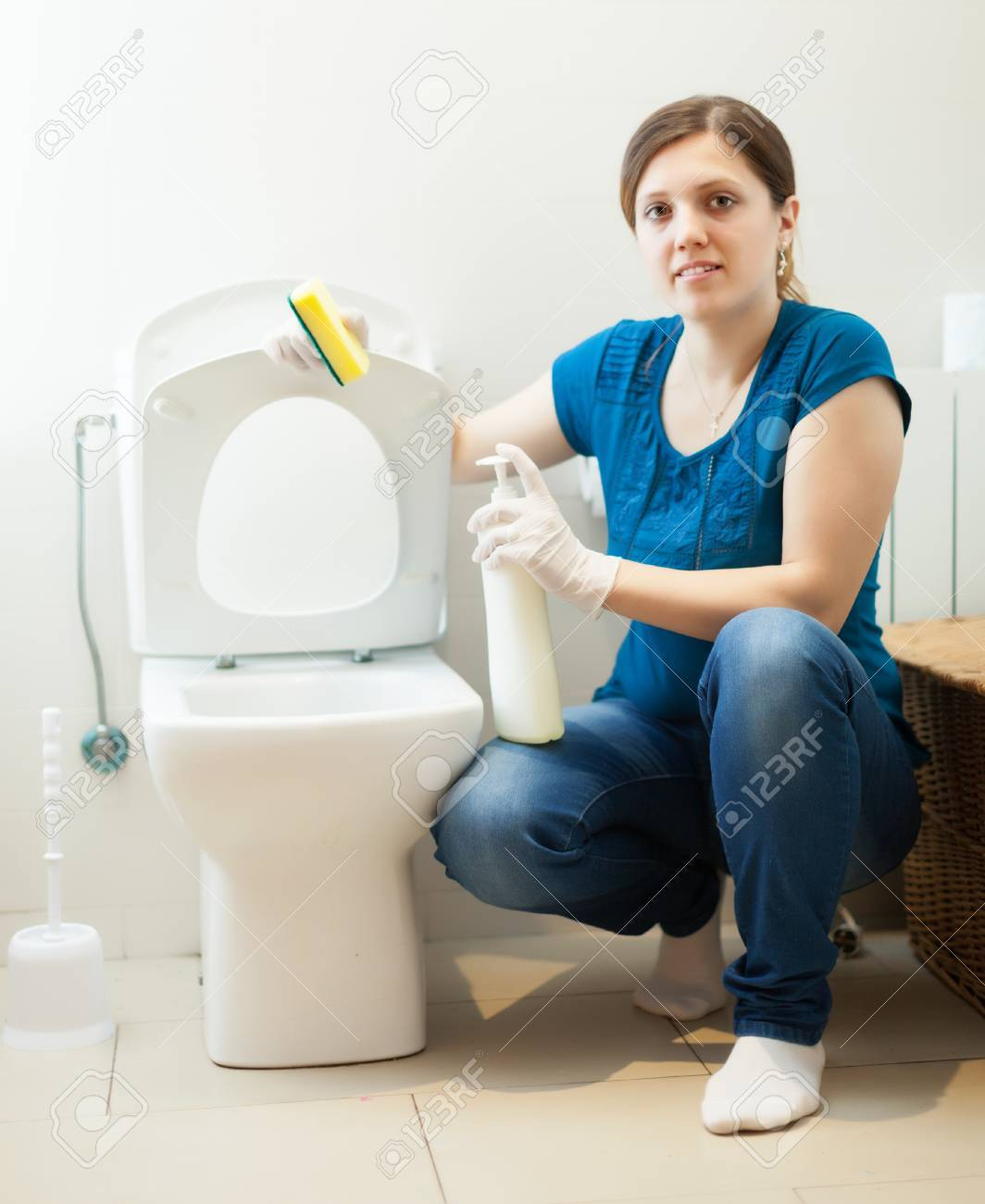 woman cleaning toilet with sponge and cleaner at  home Stock Photo - 22817637